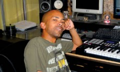 Dialect HD works on a new track in his studio at his home. Photo by Amy Beck